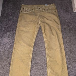 Khaki true religion jeans with white stich